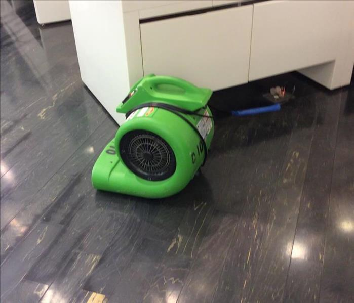 Hardwood Floor Drying at a Retail Store After